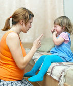 Woman scolds crying child — Stock Photo