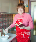 Woman making dough — Stock Photo