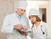 Doctor and nurse in hospital interior — Stock Photo