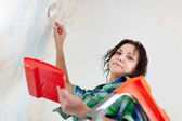 Woman paints at home — Stock Photo