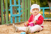 Two-year child playing with sand — Stock Photo