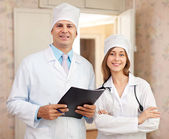 Friendly doctors in clinic interior — Stock Photo