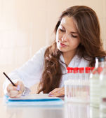 Nurse working in medical laboratory — Stock Photo