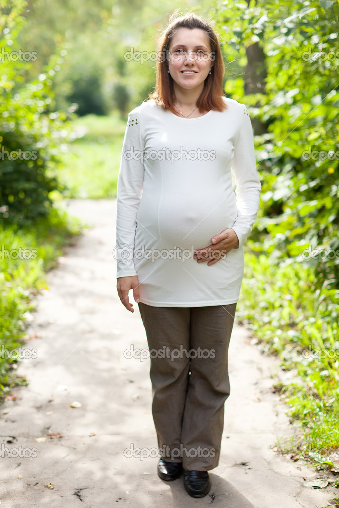 Full length of pregnant woman walking in park — Stock Photo #18199613
