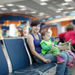 Mother and child at airport — Stock Photo #18200119