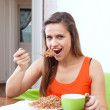 Stock Photo: Womeats buckwheat porridge
