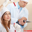 Male doctor and nurse with test tubes - Foto Stock