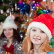 Young women celebrating Christmas — Stok fotoğraf