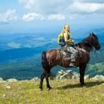 Rider on horseback at mountains — Stock Photo #18200393