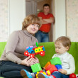Stock Photo: Mother and baby plays with toys