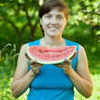Woman  with fresh watermelon - Stock Photo