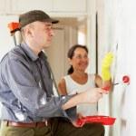 Woman and man making repairs at room — Stock Photo #18200499