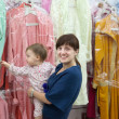 Royalty-Free Stock Photo: Happy woman and child chooses clothes