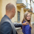 The man stops woman - Stockfoto