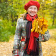 mature woman  in autumn park — Stock Photo