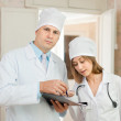 Doctor and nurse in hospital - Stock Photo
