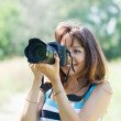 Female photographer takes photo — Stock Photo #18200675