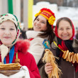 Young girl with pancake during  Shrovetide — Stock Photo