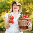 Woman with vegetables in garden — Stock Photo