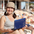mature woman  with laptop at  beach — Stock Photo