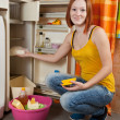 Woman defrosting the refrigerator — Stock Photo