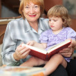 Grandmother and baby reading book — Stock Photo