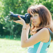 Beautiful  photographer takes photo — Stock Photo