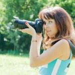Beautiful photographer takes photo — Stock Photo #18201645