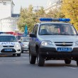 Stock Photo: Police cars in carnival procession