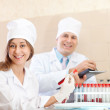 Stock Photo: Male doctor and nurse makes blood test