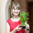 Girl with lucky bamboo — Stock Photo