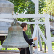 Monk is rings the bells of Assumption cathedral — Lizenzfreies Foto