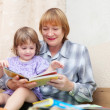 Grandmother and baby reading book — Stock Photo #18201783