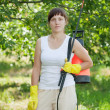 Woman with garden spray — Stock Photo