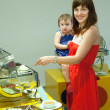 Mother with child in hotel buffet — Stock Photo