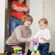 Parents and child plays with meccano — Stock Photo