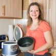 Stock Photo: Woman with electric slow cooker