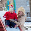 Happy mother with toddler in winter — Stock Photo #18203593