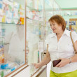 Royalty-Free Stock Photo: woman buys drugs at the pharmacy