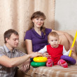 Parents with toddler in home — Stock Photo