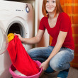 Woman doing laundry — Stock Photo