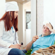 Doctor of prescribes to patient the medication - Stock Photo