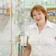Mature woman in pharmacy drugstore — Stock Photo
