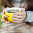 Royalty-Free Stock Photo: cup in woman hands