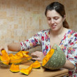 Woman cooks pumpkin - Stock Photo