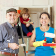 Stock Photo: Parents with child repairs at home