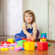 Stock Photo: Girl plays with toys in home