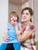 Woman wipes snot child at home — Stock Photo