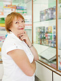 Woman chooses contraceptives — Stock Photo