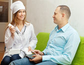 Nurse gives to patient the medication — Stock Photo